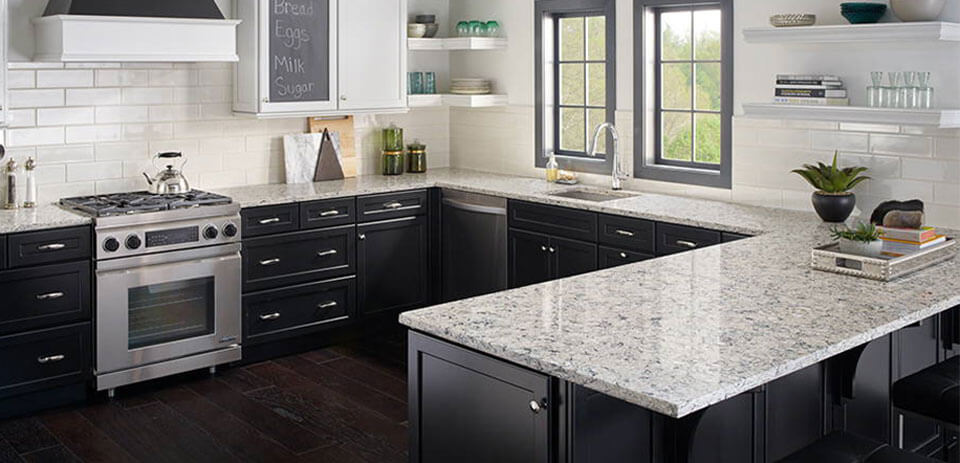 redesigned kitchen with quartz countertops and black cabinetry