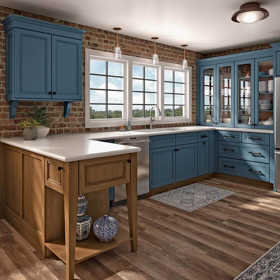 Cornflower blue kitchen cabinets with white countertops and light wood peninsula.