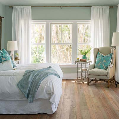 white double-hung windows in green and white bedroom